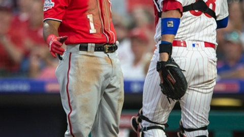 Washington Nationals' Wilmer Difo (1) reacts after striking out in the sixth inning of the team's baseball game against the Philadelphia Phillies, Saturday, June 30, 2018, in Philadelphia. The Phillies won 3-2. (AP Photo/Laurence Kesterson)
