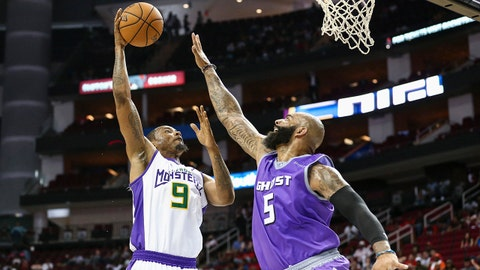 Jun 22, 2018; Houston, TX, USA; 3 Headed Monsters Rashard Lewis (9) shoots the ball as Ghost Ballers Carlos Boozer (5) defends during the game at Toyota Center. Mandatory Credit: Troy Taormina-USA TODAY Sports