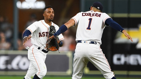 Jun 20, 2018; Houston, TX, USA; Houston Astros second baseman Tony Kemp (18) is greeted by shortstop Carlos Correa (1) after making a play in the outfield during the first inning against the Tampa Bay Rays at Minute Maid Park. Mandatory Credit: Shanna Lockwood-USA TODAY Sports
