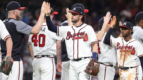 Jun 14, 2018; Atlanta, GA, USA; Atlanta Braves shortstop Dansby Swanson (7) and second baseman Ozzie Albies (1) celebrate with teammates after their win against the San Diego Padres at SunTrust Park. Mandatory Credit: Jason Getz-USA TODAY Sports