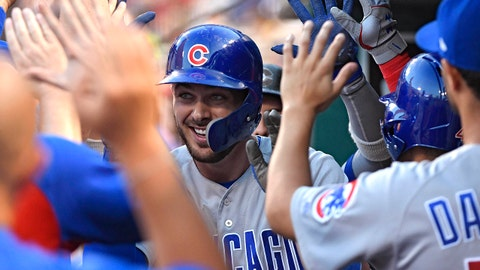Jun 15, 2018; St. Louis, MO, USA; Chicago Cubs third baseman Kris Bryant (17) is congratulated by teammates after hitting a two run home run off of St. Louis Cardinals starting pitcher Michael Wacha (not pictured) during the third inning at Busch Stadium. Mandatory Credit: Jeff Curry-USA TODAY Sports