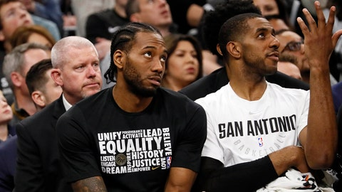 Feb 3, 2018; San Antonio, TX, USA; San Antonio Spurs small forward Kawhi Leonard (left) and LaMarcus Aldridge (12) react on the bench during the first half against the Utah Jazz at AT&T Center. Mandatory Credit: Soobum Im-USA TODAY Sports