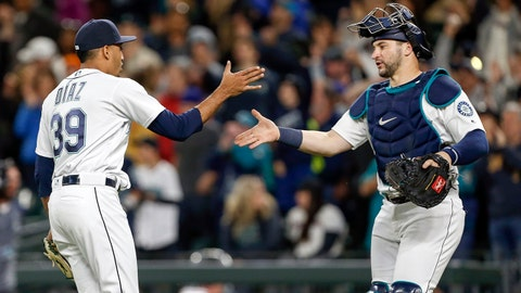 Jun 11, 2018; Seattle, WA, USA; Seattle Mariners relief pitcher Edwin Diaz (39) celebrates with catcher Mike Zunino (3) following the final out of a 5-3 victory against the Los Angeles Angels at Safeco Field. Mandatory Credit: Joe Nicholson-USA TODAY Sports