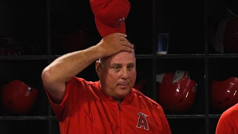 Jun 2, 2018; Anaheim, CA, USA; Los Angeles Angels manager Mike Scioscia (14) reacts after Los Angeles Angels relief pitcher Blake Parker (53) walks a batter in the ninth inning against the Texas Rangers at Angel Stadium of Anaheim. Mandatory Credit: Jayne Kamin-Oncea-USA TODAY Sports