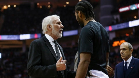 Dec 15, 2017; Houston, TX, USA; San Antonio Spurs head coach Gregg Popovich talks with forward Kawhi Leonard (2) during the third quarter against the Houston Rockets at Toyota Center. Mandatory Credit: Troy Taormina-USA TODAY Sports