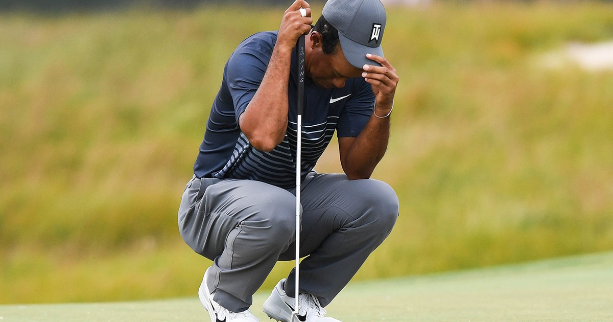 tiger woods in danger of missing the cut after shooting 8