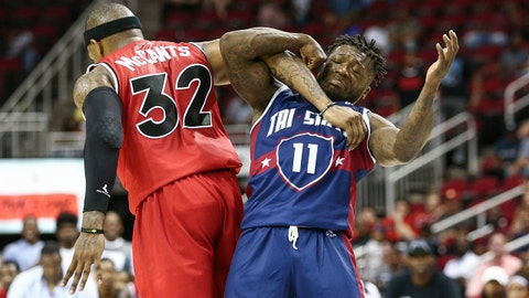 Jun 22, 2018; Houston, TX, USA; Trilogy Rashad McCants (32) and Tri State Nate Robinson (11) lock arms after a play during the game at Toyota Center. Mandatory Credit: Troy Taormina-USA TODAY Sports