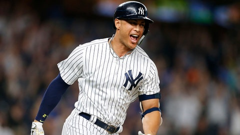Jun 20, 2018; Bronx, NY, USA; New York Yankees left fielder Giancarlo Stanton (27) rounds the bases after hitting a walk off home run against the Seattle Mariners at Yankee Stadium. Mandatory Credit: Noah K. Murray-USA TODAY Sports