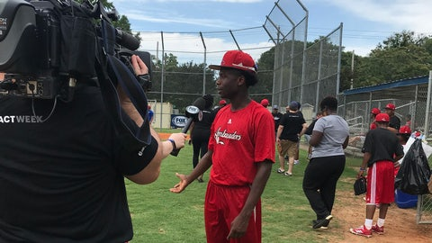 Mentoring high school students at LEAD through baseball training stations