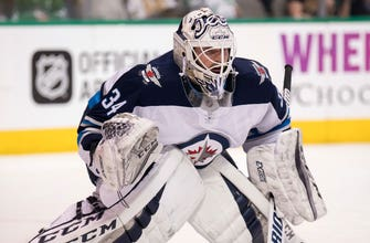 Panthers sign former Jet goaltender Michael Hutchinson to a one-year, one-way contract