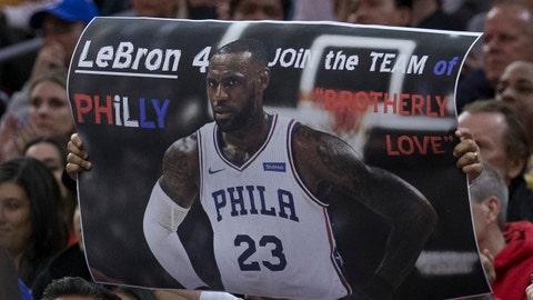 PHILADELPHIA, PA - APRIL 6: A Philadelphia 76ers fan holds up a sign of LeBron James #23 in a 76ers uniform during the game against the Cleveland Cavaliers at the Wells Fargo Center on April 6, 2018 in Philadelphia, Pennsylvania. NOTE TO USER: User expressly acknowledges and agrees that, by downloading and or using this photograph, User is consenting to the terms and conditions of the Getty Images License Agreement. (Photo by Mitchell Leff/Getty Images) *** Local Caption *** LeBron James