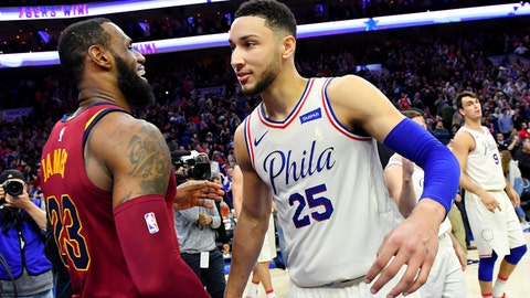 PHILADELPHIA, PA - APRIL 6:  LeBron James #23 of the Cleveland Cavaliers and Ben Simmons #25 of the Philadelphia 76ers exchange a hug after the game between the two teams on April 6, 2018 in Philadelphia, Pennsylvania NOTE TO USER: User expressly acknowledges and agrees that, by downloading and/or using this Photograph, user is consenting to the terms and conditions of the Getty Images License Agreement. Mandatory Copyright Notice: Copyright 2018 NBAE (Photo by Jesse D. Garrabrant/NBAE via Getty Images)