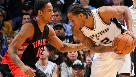 SAN ANTONIO, TX - MARCH 10:  Kawhi Leonard #2 of the San Antonio Spurs handles the ball against DeMar DeRozan #10 of the Toronto Raptors on March 10, 2015 at the AT&T Center in San Antonio, Texas. NOTE TO USER: User expressly acknowledges and agrees that, by downloading and or using this Photograph, user is consenting to the terms and conditions of the Getty Images License Agreement. Mandatory Copyright Notice: Copyright 2015 NBAE (Photo by D. Clarke Evans/NBAE via Getty Images)