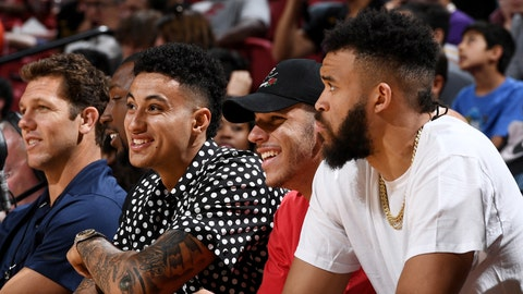 LAS VEGAS, NV - JULY 7:  Head Coach Luke Walton Kyle Kuzma #0 Lonzo Ball #0 and JaVale McGee of the the Los Angeles Lakers look on during the game against the the Philadelphia 76ers during the 2018 Las Vegas Summer League on July 7, 2018 at the Thomas & Mack Center in Las Vegas, Nevada. NOTE TO USER: User expressly acknowledges and agrees that, by downloading and/or using this Photograph, user is consenting to the terms and conditions of the Getty Images License Agreement. Mandatory Copyright Notice: Copyright 2018 NBAE (Photo by Garrett Ellwood/NBAE via Getty Images)