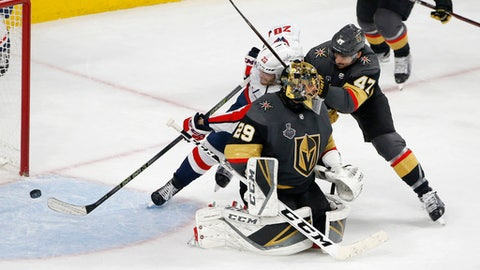 Washington Capitals center Lars Eller (20) scores on Vegas Golden Knights goaltender Marc-Andre Fleury, front, while under pressure from defenseman Luca Sbisa during the third period in Game 5 of the NHL hockey Stanley Cup Finals Thursday, June 7, 2018, in Las Vegas. (AP Photo/Ross D. Franklin)