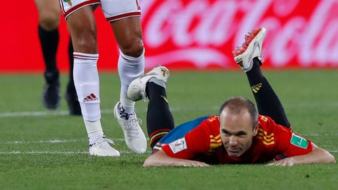 Spain's Andres Iniesta lies on the ground during the group B match between Spain and Morocco at the 2018 soccer World Cup at the Kaliningrad Stadium in Kaliningrad, Russia, Monday, June 25, 2018. (AP Photo/Manu Fernandez)