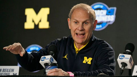 FILE - In this March 21, 2018, file photo, Michigan head coach John Beilein speaks during a news conference at the NCAA men's college basketball tournament, in Los Angeles. After briefly emerging as a candidate for the Detroit Pistons' job, John Beilein is back at Michigan amid high expectations for next season.  (AP Photo/Mark J. Terrill, File)