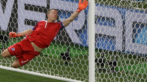 Iceland goalkeeper Hannes Halldorsson dives during the group D match between Iceland and Croatia, at the 2018 soccer World Cup in the Rostov Arena in Rostov-on-Don, Russia, Tuesday, June 26, 2018. (AP Photo/Mark Baker)