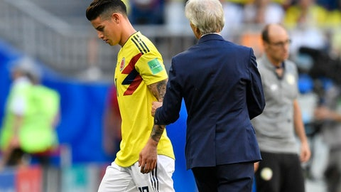 Colombia's James Rodriguez, left, walks past Colombia head coach Jose Pekerman, right, as he leaves the pitch during the group H match between Senegal and Colombia, at the 2018 soccer World Cup in the Samara Arena in Samara, Russia, Thursday, June 28, 2018. (AP Photo/Martin Meissner)