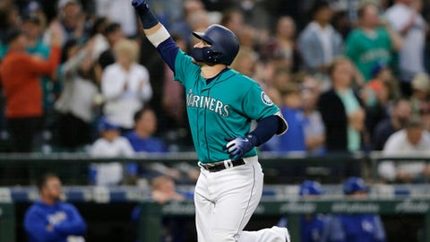 Seattle Mariners' Mike Zunino points as he runs to home plate after hitting a solo home run off Kansas City Royals starting pitcher Ian Kennedy during the fifth inning of a baseball game, Friday, June 29, 2018, in Seattle. (AP Photo/John Froschauer)