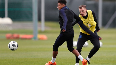 England's Jesse Lingard, left vies for the ball with England's Phil Jones as they take part in a training session for the England team at the 2018 soccer World Cup, in the Spartak Zelenogorsk ground, Zelenogorsk near St. Petersburg, Russia, Saturday, June 30, 2018. (AP Photo/Alastair Grant)