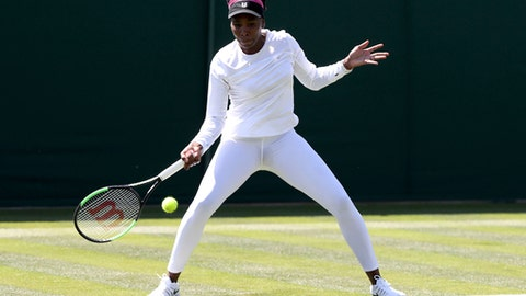 Venus Williams practices on the grass court at Wimbledon, ahead of the start of the 2018 Wimbledon Tennis Championships, in London, Saturday June 30, 2018.  Williams is scheduled to play Sweden's Johanna Larsson at Wimbledon on July 2. (John Walton/PA via AP)