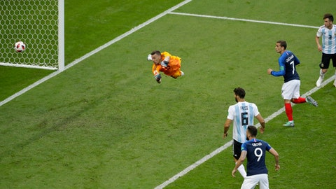 Argentina goalkeeper Franco Armani dives as France's Benjamin Pavard scores his side's second goal during the round of 16 match between France and Argentina, at the 2018 soccer World Cup at the Kazan Arena in Kazan, Russia, Saturday, June 30, 2018. (AP Photo/Sergei Grits)