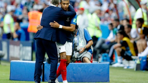 France head coach Didier Deschamps hugs Kylian Mbappe during the round of 16 match between France and Argentina, at the 2018 soccer World Cup at the Kazan Arena in Kazan, Russia, Saturday, June 30, 2018. (AP Photo/David Vincent)