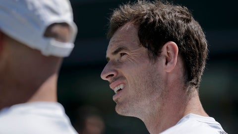 Andy Murray of Britain sits during a practice session ahead of the Wimbledon Tennis Championships in London Saturday, June 30, 2018. (AP Photo/Ben Curtis)