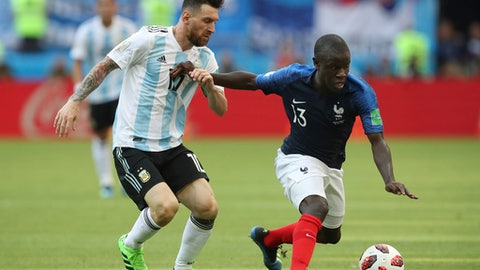 France's Ngolo Kante, right, fends off a challenge from Argentina's Lionel Messi during the round of 16 match between France and Argentina, at the 2018 soccer World Cup at the Kazan Arena in Kazan, Russia, Saturday, June 30, 2018. (AP Photo/Thanassis Stavrakis)
