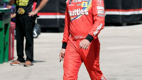 Kyle Busch walks to his garage during a practice session for the NASCAR Cup Series auto race at Chicagoland Speedway in Joliet, Ill., Saturday, June 30, 2018. (AP Photo/Nam Y. Huh)