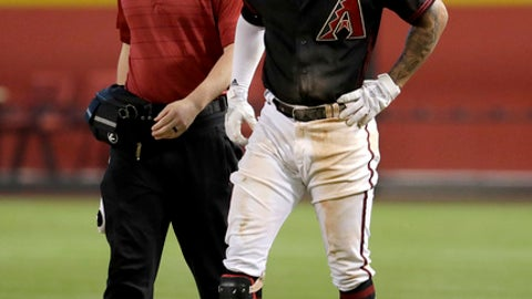 Arizona Diamondbacks shortstop Ketel Marte limps to the dugout after being thrown out at first during the seventh inning of a baseball game against the San Francisco Giants on Saturday, June 30, 2018, in Phoenix. Marte left the game. (AP Photo/Matt York)