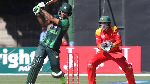 Pakistan batsman Fakhar Zaman plays a shot during the T20 cricket match against Zimbabwe at Harare Sports Club, Sunday, July 1, 2018.  Zimbabwe is playing host to a tri-nation Twenty20 international series with Australia and Pakistan.(AP Photo/Tsvangirayi Mukwazhi)