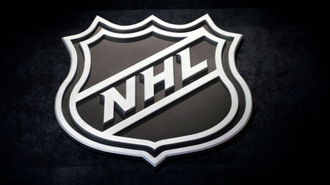 FILE - In this June 26, 2015, file photo, an NHL logo is shown before the start of the first round of the NHL hockey draft, in Sunrise, Fla. The NHL Free Agency period begins at noon Sunday, July 1, 2018. (AP Photo/Alan Diaz, File)