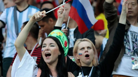Russia's fans celebrate after the round of 16 match between Spain and Russia at the 2018 soccer World Cup at the Luzhniki Stadium in Moscow, Russia, Sunday, July 1, 2018. (AP Photo/Alexander Zemlianichenko)