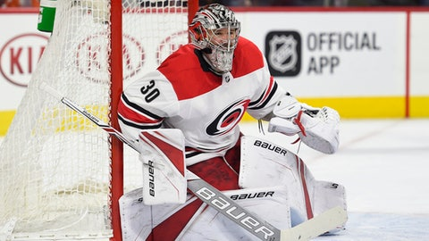 FILe - In this March 1, 2018, file photo, Carolina Hurricanes goalie Cam Ward looks for the puck during the second period of an NHL hockey game against the Philadelphia Flyers, in Philadelphia. The Chicago Blackhawks agreed to contracts with free agents Chris Kunitz, Cam Ward and Brandon Manning on Sunday, July 1, 2018, addressing their depth in every position group after missing the playoffs for the first time in a decade. Kunitz got a one-year deal worth $1 million, and Wards one-year contract is for $3 million. Manning received a two-year deal. (AP Photo/Derik Hamilton, File)