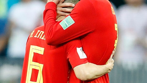 Spain's Gerard Pique, right, comforts Spain's Andres Iniesta after losing by penalty shootout the round of 16 match between Spain and Russia at the 2018 soccer World Cup at the Luzhniki Stadium in Moscow, Russia, Sunday, July 1, 2018. (AP Photo/Antonio Calanni)