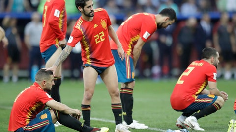 Spain's Isco comfort ]Koke during penalty shootout of the round of 16 match between Spain and Russia at the 2018 soccer World Cup at the Luzhniki Stadium in Moscow, Russia, Sunday, July 1, 2018. (AP Photo/Matthias Schrader)
