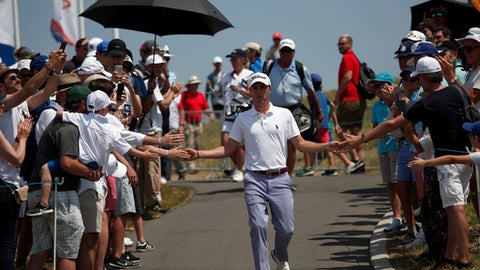 Justin Thomas of the U.S. is greeted by fans as he arrives at the first hole during the last day of the French Open de France Golf tournament at the Albatros Course in Guyancourt, south west of Paris, France, Sunday, July 1, 2018. The 42nd Ryder Cup Matches will be held in France from 28-30 September 2018 at the Albatros Course of Le Golf National. (AP Photo/Francois Mori)