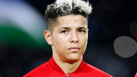 FILE - In this file photo from March 27, 2018, Morocco midfielder Amine Harit prior to the start of a friendly soccer match between Morocco and Uzbekistan in Casablanca, Morocco. (AP Photo/Abdeljalil Bounhar, File)