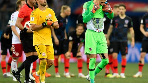 Denmark goalkeeper Kasper Schmeichel, left, and Croatia goalkeeper Danijel Subasic prepare for the penalty shootout during the round of 16 match between Croatia and Denmark at the 2018 soccer World Cup in the Nizhny Novgorod Stadium, in Nizhny Novgorod , Russia, Sunday, July 1, 2018. (AP Photo/Martin Meissner)