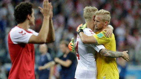 Denmark goalkeeper Kasper Schmeichel, right, hugs his teammate Simon Kjaer after the round of 16 match between Croatia and Denmark at the 2018 soccer World Cup in the Nizhny Novgorod Stadium, in Nizhny Novgorod, Russia, Sunday, July 1, 2018. Croatia eliminates Denmark 3-2 on penalties after game ends 1-1. (AP Photo/Gregorio Borgia)