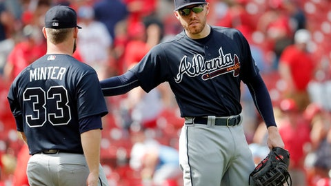 Atlanta Braves' Freddie Freeman, right, celebrates with relief pitcher A.J. Minter (33) following a baseball game against the St. Louis Cardinals Sunday, July 1, 2018, in St. Louis. The Braves won 6-5. (AP Photo/Jeff Roberson)