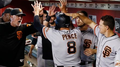 San Francisco Giants' Hunter Pence (8) celebrates his run scored against the Arizona Diamondbacks with assistant hitting coach Rick Schu, left, Austin Slater, second from right, and Nick Hundley, right, during the fifth inning of a baseball game Sunday, July 1, 2018, in Phoenix. (AP Photo/Ross D. Franklin)
