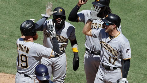 Pittsburgh Pirates' Colin Moran (19) is greeted by teammates Josh Harrison, second from left, Josh Bell, second from right, and Austin Meadows (17) after hitting a grand slam during the fifth inning of a baseball game against the San Diego Padres, Sunday, July 1, 2018, in San Diego. (AP Photo/Gregory Bull)