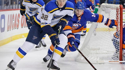 FILE - In this Monday, Oct. 9, 2017, file photo, St. Louis Blues' Tage Thompson (32) moves the puck behind the net while New York Islanders' Thomas Hickey chases during the first period of an NHL hockey game, in New York. Thompson, the Blues' first-round pick in the 2016 draft, was traded to the Buffalo Sabres, Sunday, July 1, 2018. (AP Photo/Seth Wenig, File)
