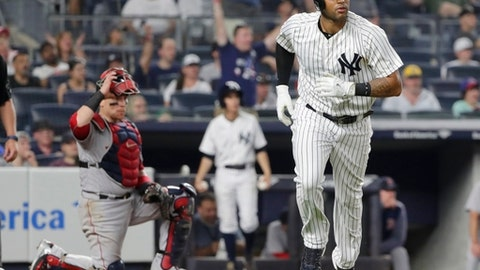 New York Yankees' Aaron Hicks, right, runs the bases after hitting a home run, as Boston Red Sox catcher Christian Vazquez, left, reacts during the eighth inning of a baseball game, Sunday, July 1, 2018, in New York. (AP Photo/Frank Franklin II)