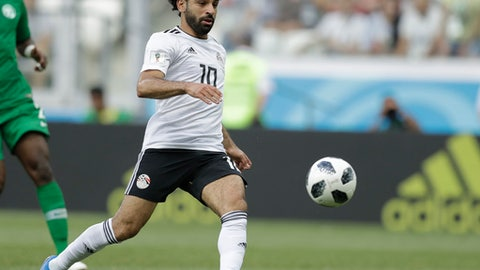 FILE - In this Monday, June 25, 2018, file photo, Egypt's Mohamed Salah chases the ball during the group A match between Saudi Arabia and Egypt at the 2018 soccer World Cup at the Volgograd Arena in Volgograd, Russia. The English Premier League top scorer Salah has signed a new five-year contract with Liverpool. (AP Photo/Andrew Medichini, File)