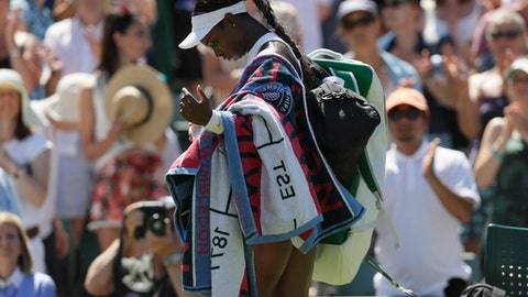 Sloane Stephens of the US walks off the court after being defeated by Donna Vekic of Croatia in the Women's Singles first round match at the Wimbledon Tennis Championships in London, Monday July 2, 2018. (AP Photo/Kirsty Wigglesworth)