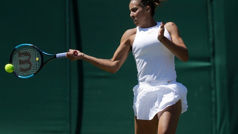 Madison Keys of the US plays a return to Ajla Tomljanovic of Australia during the Women's Singles first round match at the Wimbledon Tennis Championships in London, Monday July 2, 2018. (AP Photo/Ben Curtis)